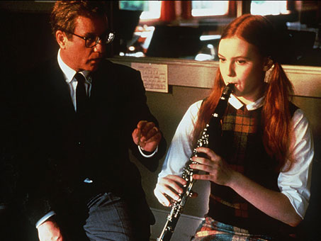 Mr. Holland coaches Gertrude (Alicia Witt) who'll later play an important part in his life.